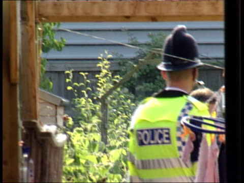 Alleged bombers Hasib Hussain and Mohammad Sidique Khan background Aylesbury GV police and forensic officers outside home of Germaine Lindsay...