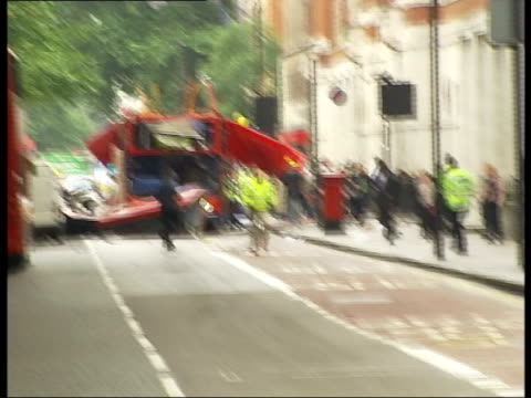 bus bomb: tavistock square; england: london: russell square/tavistock square: ext gvs bomb damaged bus with roof missing police directing traffic gvs... - directing stock videos & royalty-free footage