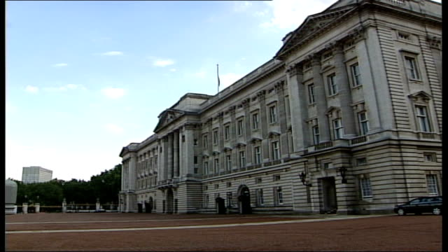 Flag flying at half mast at Buckingham Palace ITN Audio track 1 FX / Audio track 2 FX ENGLAND London Buckingham Palace EXT GVs Union Jack flag flying...