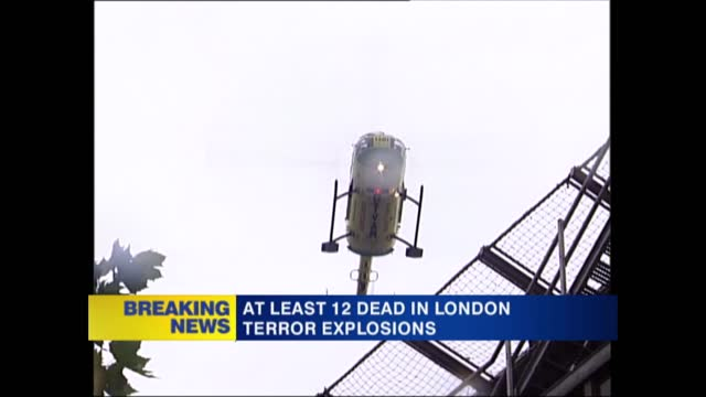 news openender 13.30 - 14.30; england: london: ext injured person pushed along on trolley stretcher with blue monitor on them ground to air air... - hovering stock videos & royalty-free footage