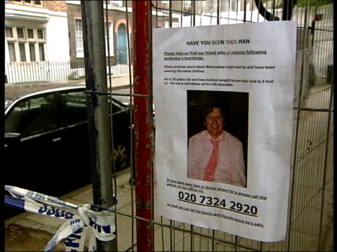 more victims named/ search for missing people london ms poster on wire fence in street with image of jamie gordon and message asking for information... - missing poster stock videos & royalty-free footage