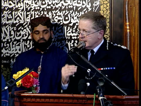muslim leaders condemn attacks/ian blair urges cooperation; england: essex: romford: int bvs muslim men praying in mosque sir ian blair arriving at... - west yorkshire stock videos & royalty-free footage
