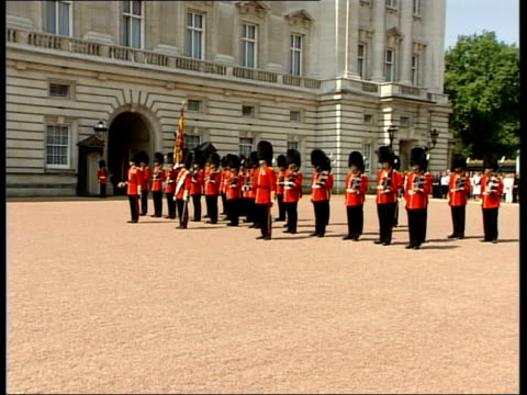 Queen Elizabeth II observes two minute silence ENGLAND London Buckingham Palace Guards band playing in front of palace SOT / Queen Elizabeth II...