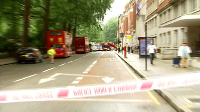 Families of victims ask for memorial in Tavistock Square 772005 Remains of bus destroyed by suicide bomb attack emergency services at the scene