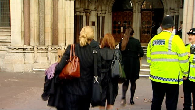 inquest begins england london the strand royal courts of justice ext court workers carrying boxes of legal documents along to court lady justice... - the strand london stock videos and b-roll footage
