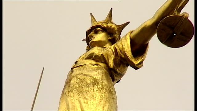 final day of evidence t21021108 old bailey pan up gold statue of lady justice - statue of justice london stock videos and b-roll footage