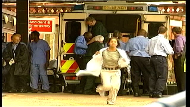 review of emergency services response tx location unknown ext victim stretchered along medical workers around rear of ambulance injured man helped... - casualty stock videos & royalty-free footage