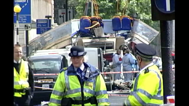 widow of suicide bomber loses legal appeal 7 july 2005 england london ext ambulances along street wreckage of bus 7/7 bombings - legal appeal stock videos & royalty-free footage