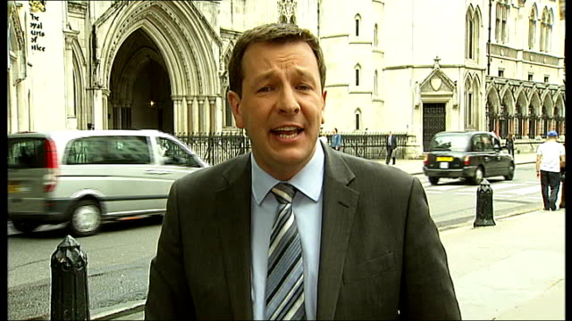 widow of suicide bomber loses legal appeal general view of royal courts of justice reporter to camera clifford tibber interview sot - widow stock videos and b-roll footage