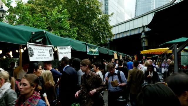 london borough outdoor market tilt up (4k/uhd to hd) - market stall stock videos & royalty-free footage