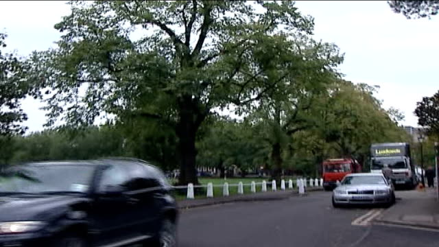 london borough to charge unenvironmental cars for parking england london richmond upon thames ext low angle view of trees pull out traffic along in... - richmond upon thames stock-videos und b-roll-filmmaterial