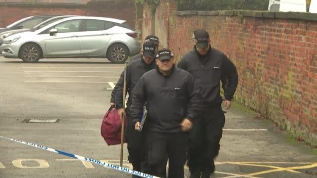 london bridge attack: attacker named as convicted terrorist usman khan; england: staffordshire: stafford: ext police officers along cars along... - リチャード・パロット点の映像素材/bロール