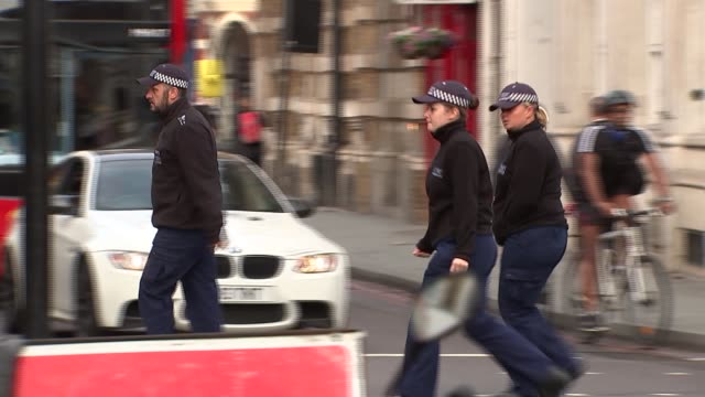borough market cordon and flowers england london borough ext gvs police cordon at borough market / police officers along in area / plastic sheeting... - 仮設追悼施設点の映像素材/bロール