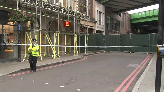 further tribues paid to victiums / survivors speak out ENGLAND London Borough EXT Borough Market sign PULL OUT police cordon with metal barrier...