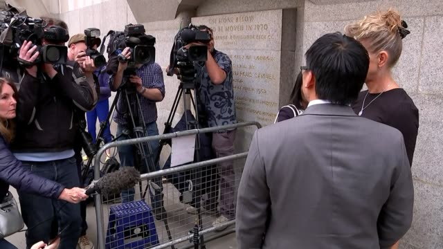 stabbing survivor geoffrey ho describes attackers approach england london old bailey ext various shots of geoffrey ho facing press supported by julie... - inquest stock videos and b-roll footage