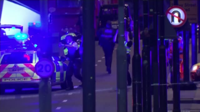 Inquests open into deaths of five victims T04061715 / TX London Bridge Police officers and police vehicles with flashing lights in street Police...