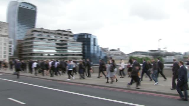 Latest on the investigation London Bridge People along London Bridge Tower Bridge in background Commuters along London Bridge PAN Reporter to camera...