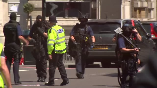 seven killed and 48 injured armed police officers along street police officers along street - london bridge england stock videos & royalty-free footage
