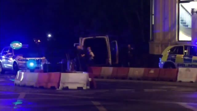 seven killed and 48 injured ext police cars with lights flashing and sirens sounding surrounding white van used in attack after it crashed vox pops... - london bridge england stock videos & royalty-free footage