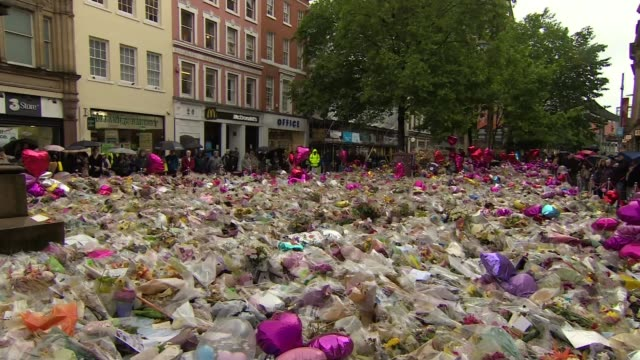 third attacker and more victims named england manchester ext people observing silence near mass of floral tributes for victims of manchester arena... - manchester arena stock videos & royalty-free footage