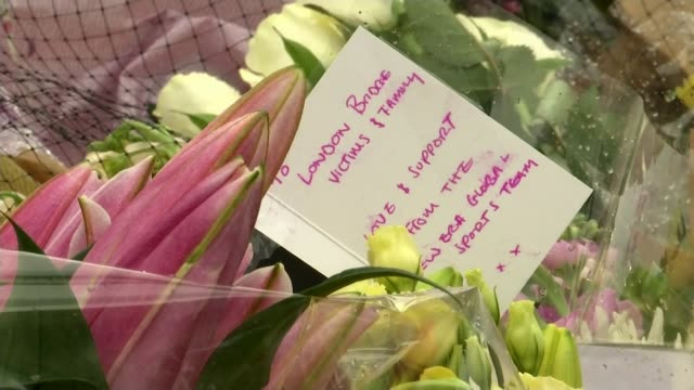 third attacker and more victims named england london london bridge ext man handing out free roses to people vox pops woman laying roses roses laid... - pastor stock videos & royalty-free footage