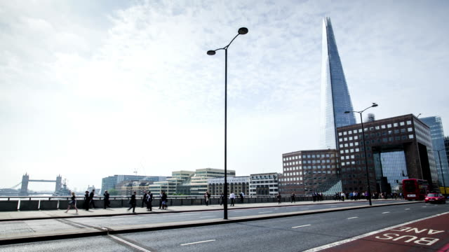 london bridge rush hour with view on shard, time lapse - london bridge england stock videos & royalty-free footage