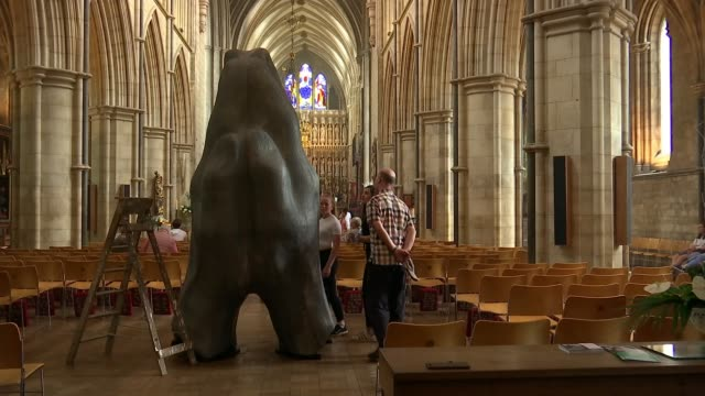 New sculpture to be installed in Southwark Cathedral to commemorate second anniversary of attack ENGLAND London Southwark INT People along looking at...