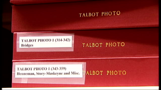british library: int reporter and curator into room william henry fox talbot photograph collection on shelves curator showing photograph album... - curator stock videos & royalty-free footage