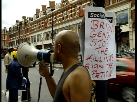 london brixton ext gv boarded up window of 'morleys' shop with 'open for business' sign pan ms boarded up smashed shop window bv male protestor... - ブリックストン点の映像素材/bロール
