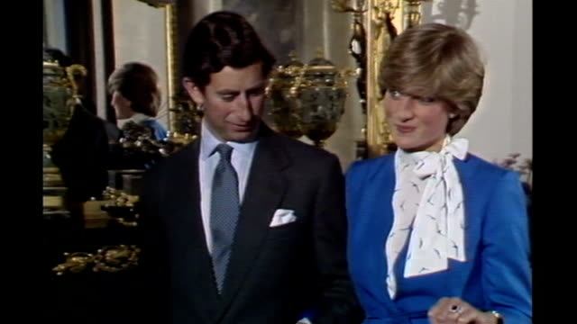 london buckingham palace int prince charles and then fiancee lady diana spencer interview on announcement of their engagement and diana with sapphire... - stone object stock videos & royalty-free footage