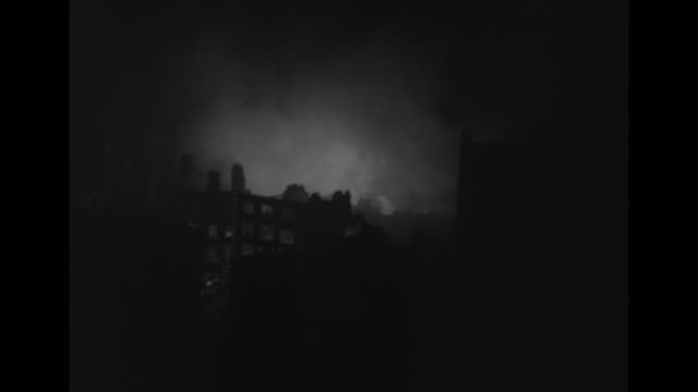 ls london burning after german air raid / ls fireman climbing ladder silhouetted against light from burning buildings in background / ms flames and... - london blitz stock videos and b-roll footage