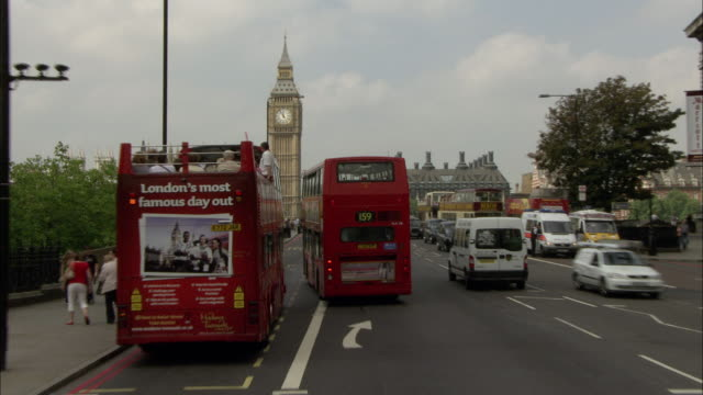 WS POV London Bus on city street passing by  Houses of Parliament and Big Ben across Westminster Bridge / Westminster London, England