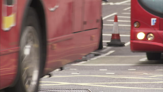 London buses and black cabs move along a London street Available in HD.