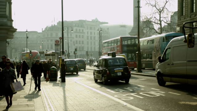 London buses at Trafalgar Square on nice sunny day