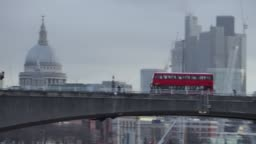 London Buses go past St Paul's Cathedral at dawn