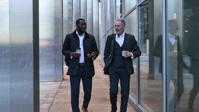 london businessmen walking and talking on coffee break - coworker stock videos & royalty-free footage
