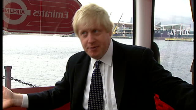 london cable car project unveiled; int cable car johnson interview sot - part of what we are trying to do with the whole of the docklands area ext... - london docklands stock videos & royalty-free footage