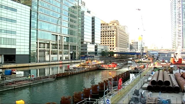 canary wharf: ext general view of construction workers using mechanical drilling equipment good shot general view of building site for first... - crane construction machinery stock videos & royalty-free footage