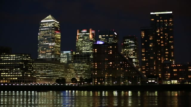 london canary wharf with river thames - city of london stock videos & royalty-free footage