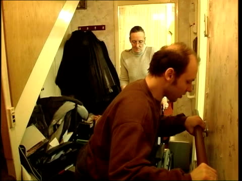 'who cares' series england london stepney green danny currie being dressed by mother sharon currie danny currie interviewed sot talks about routine... - stair lift stock videos and b-roll footage