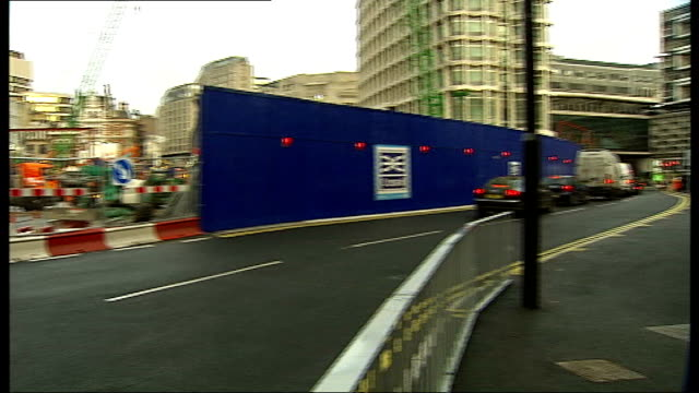 london charing cross road ext building site pan diverted traffic centre point building tilt down diverted traffic pedestrians along past construction... - charing cross stock videos and b-roll footage