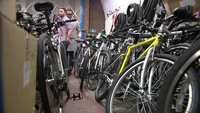 london charity fixes and donates bikes to refugees starting new lives in the uk uk london lewisham gvs bicycle workshop in deptford / jem stein... - pedal stock videos & royalty-free footage