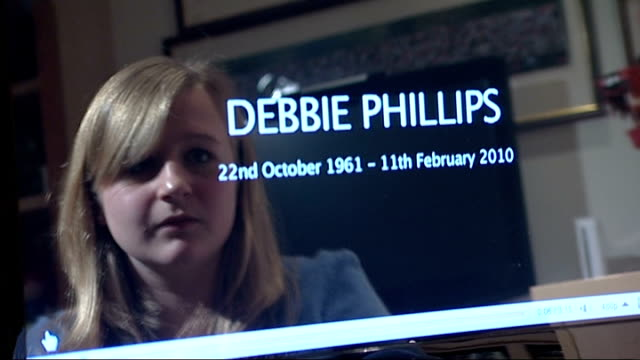London Chiswick INT Face of Sarah Phillips reflected in screen of computer showing images of Sarah's YouTube tribute