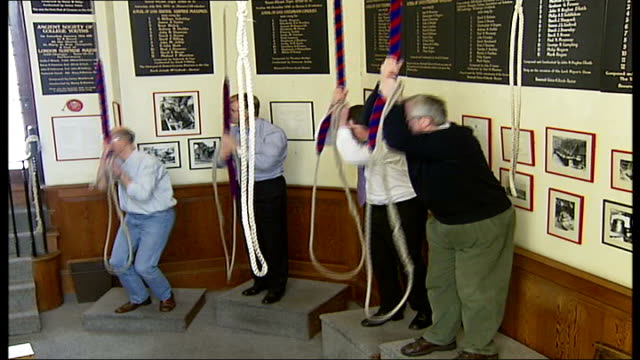 london church bells ring to mark start of 'east' festival int **mark prescott interview partially overlaid sot** bellringers pulling on bellropes - ring stock videos & royalty-free footage