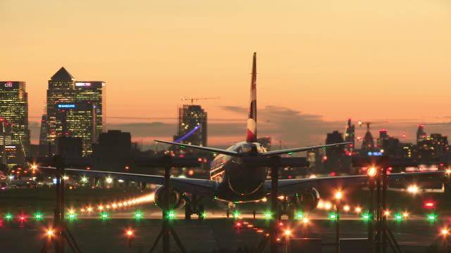 London City Airport , aircraft departs