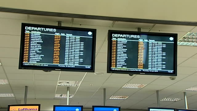 int flight departure boards showing lists of cancelled flights due to volcanic ash - ash stock videos & royalty-free footage