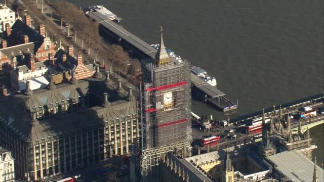 London City Airport / Parliament aerials AIR VIEWS Westminster / Houses of Parliament and Big Ben with scaffolding / plane in sky