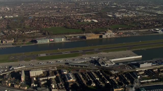 London City Airport / Parliament aerials ENGLAND London SouthEast London / Thames Barrier / London City Airport with British Airways and other planes...