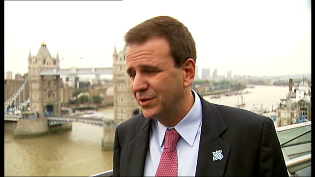 london city hall ext eduardo paes interview sot not worried about death before the olympic games / we will worry about that for everyday life... - olympic rings stock videos & royalty-free footage