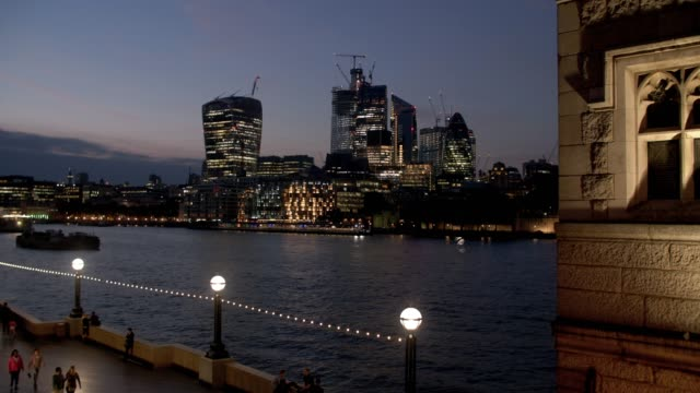 london city skyline seen from tower bridge - bridge built structure stock videos & royalty-free footage